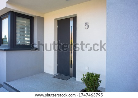 A modern single family house with a entrance doors Royalty-Free Stock Photo #1747463795