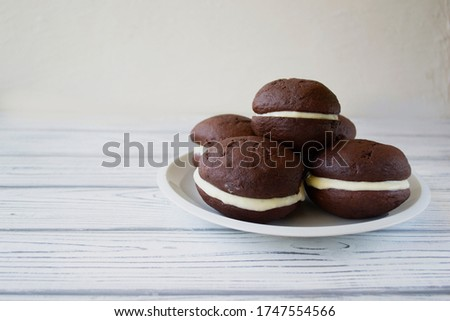 American Whoopie pies close-up on the table. horizontal view from above