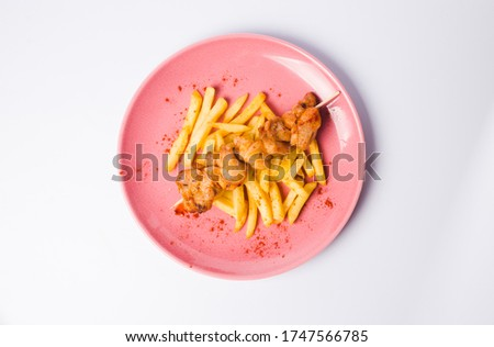 Grilled meat with French fries and vegetable salad #1747566785