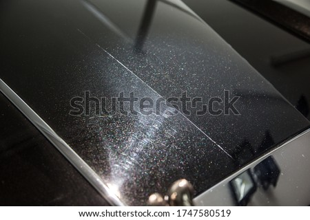 Demonstration of swirl marks on a car panel before and after polishing Royalty-Free Stock Photo #1747580519