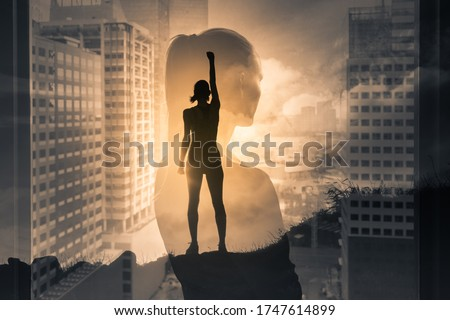 Silhouette of super strong successful business woman. Mental strength, determination, and people power, positive thinking concept. double exposure.  Royalty-Free Stock Photo #1747614899