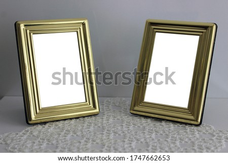 Two small vintage / retro style photo / picture frames. Old-fashioned and antique photo frames. Golden yellow photograph frames. Nice and romantic frame for couples. The desired picture can be placed.