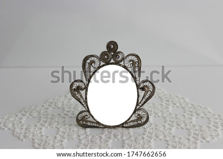 Small vintage / retro style photo / picture frame. Old-fashioned and antique photo frame. Metal and gray old photograph frame made with filigree. Made by twisting the wires. Lovely and romantic frame.