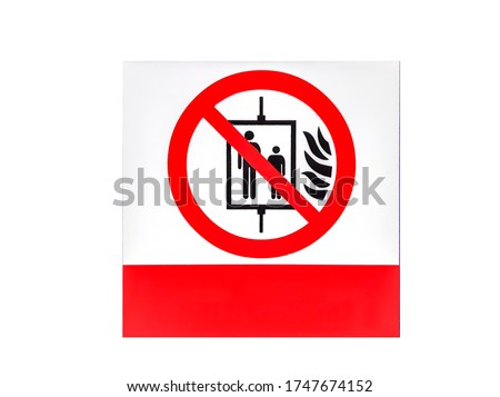 Warning sign: Do not use elevators during a fire Red prohibition sign on the top of the elevator on a white background. And there is space for adding letters with clipping path.