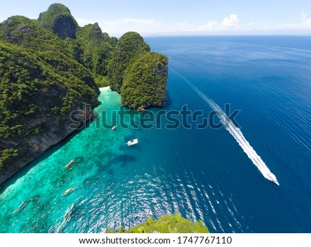 e Phi Phi islands are some of the loveliest in Southeast Asia. Just a 45-minute speedboat trip or a 90-minute ferryboat ride from either Phuket or Krabi, these picture postcard islands offer the ultim