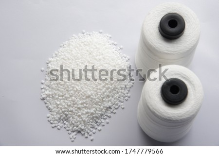White Pet Chips Semi Dull,PET chips recycle,PET polyester chips &Raw White Polyester FDY Yarn spool with white background #1747779566