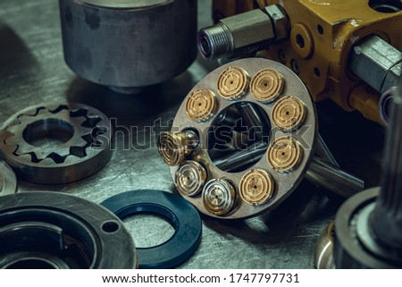 Mechanical workshop, hydraulic parts in the workshop. Grinding and polishing. Hydraulic pump repair. Royalty-Free Stock Photo #1747797731