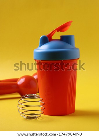 bright colorful sport items on the yellow background as keep fit concept or sport motivation idea concept
