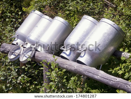 old milk canisters at a farm #174801287