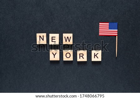 new york inscription on a black background with the American flag.