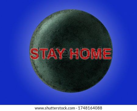 The inscription in red STAY HOME over the planet Uranus on a blue background. The concept of  quarantine self-isolation in space.