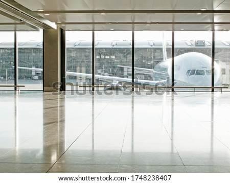 Airplane seen through window in airport terminal #1748238407