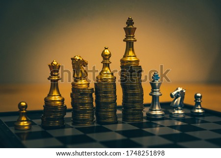 Gold coins stacks is representing riches and wealth management. Coin stack growing and find out the way to get a return on investment. Finance and money exchange investment as concept. Royalty-Free Stock Photo #1748251898