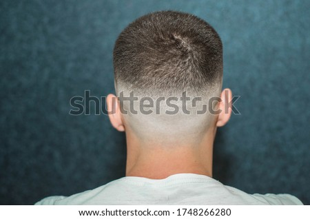 sport young man with a modern trendy fadeback haircut for barbershop. Royalty-Free Stock Photo #1748266280