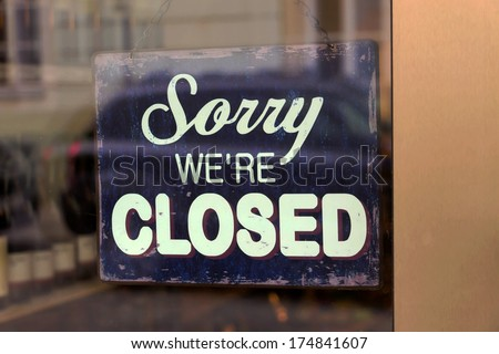 a closed shop has a sign in the schauf nests. sorry, we're closed #174841607