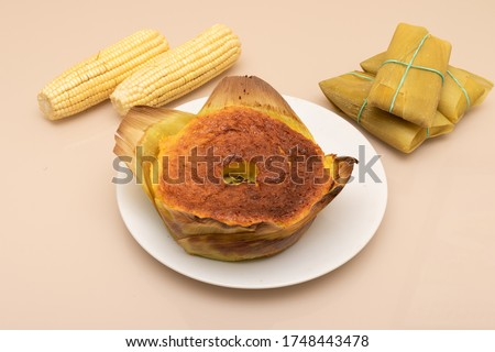 delicious corn cake with corn on the cob pictured