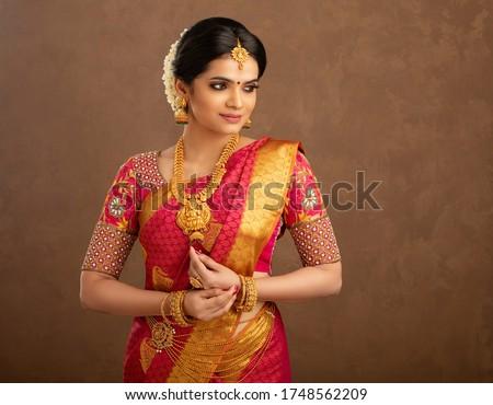 Beautiful Indian bridal in studio shot. Royalty-Free Stock Photo #1748562209