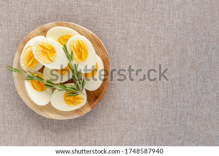 Top view of boiled eggs in wooden bowl on cotton fabric background with copy space. Boiled egg diet. #1748587940