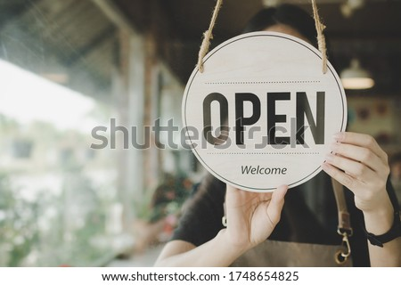 Welcome. Open. barista, waitress woman turning open sign board on glass door in modern cafe coffee shop ready to service, cafe restaurant, retail store, small business owner, food and drink concept #1748654825