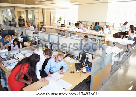 Interior Of Busy Modern Open Plan Office #174876011