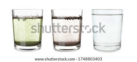 Glasses with clean and dirty water on white background Royalty-Free Stock Photo #1748803403