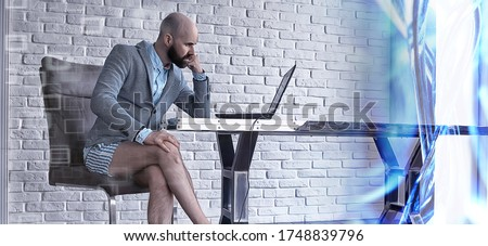 quarantined work concept, a man works at home on a computer in his underpants, funny work coronavirus pandemic meme