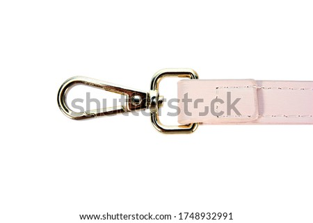 Swivel lobster clasp snap hook clip with leather shoulder bag strap isolated on white background. Metal swivel clip snap hook or gold trigger webbing bag hook isolated #1748932991