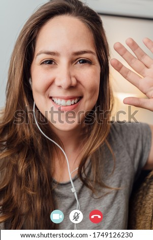 Portrait of happy 30s aged beautiful girl making facetime video calling with smartphone at home. waving on phone screen. Using conferencing meeting online app, social distancing, concept #1749126230