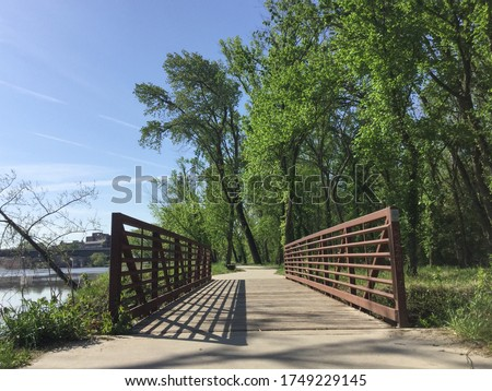 Drone images of walking, cycling, running trails in wooden, green, nature area. bridge. intersection. parks and recreation. aerial view. #1749229145