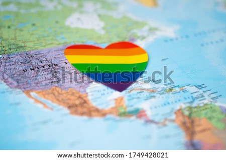 LGBT rainbow colorful heart on USA america globe world map background.