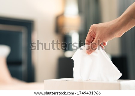 women hand picking napkin/tissue paper from the tissue box Royalty-Free Stock Photo #1749431966
