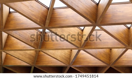 Luxurious geometric wooden triangles in construction. The concept of modern architecture, design and interior. Wood background. Modular canopy or roof.