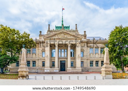 Strasbourg, Alsace region, France: Facade of the Palace of Justice, a large 19th-century neo-Greek with neo-Egyptian elements building in the Tribunal quarter of the Neustadt district Royalty-Free Stock Photo #1749548690