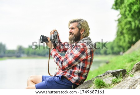 Spending carefree time. hipster man with beard use professional camera. photographer retro camera. journalist is my career. reporter make photo. vintage camera. capture these memories. SLR camera.