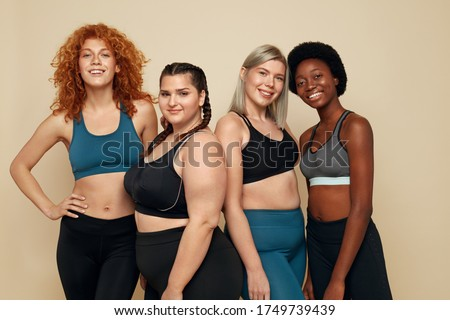 Diversity. Group Of Women Of Different Race, Figure And Size Portrait. Smiling Multi-Ethnic Female In Sportswear Posing On Beige Background. Body Positive As Lifestyle. Royalty-Free Stock Photo #1749739439