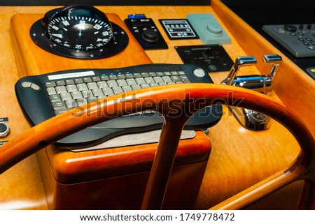 Cabin control yacht. Navigation panel with steering wheel and gearshift levers. #1749778472