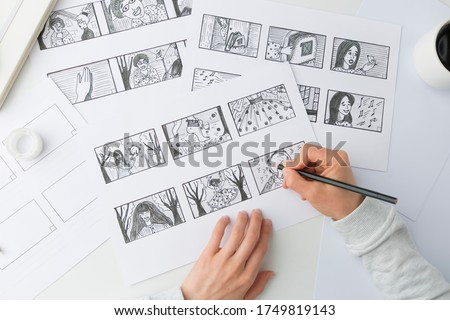 Artist illustrator draws a storyboard for the film. The animator creates sketches for the cartoon.