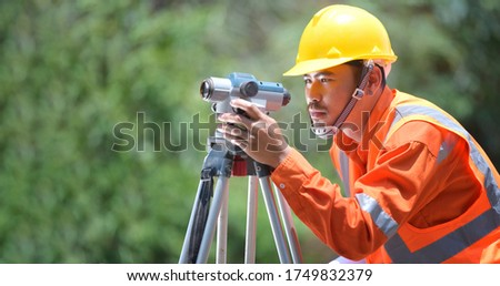 Road Surveying Equipment The telescope of the camera at the construction site or survey for mapping the shape is a graphic representation of the land laying before the construction begins. #1749832379
