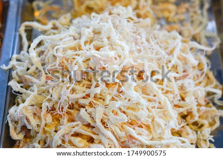 japanese sakiika, shredded and Seasoned squid, The delicious appetizers, Close-up dried squid baked, Dried squid for sale on the street market in Thailand