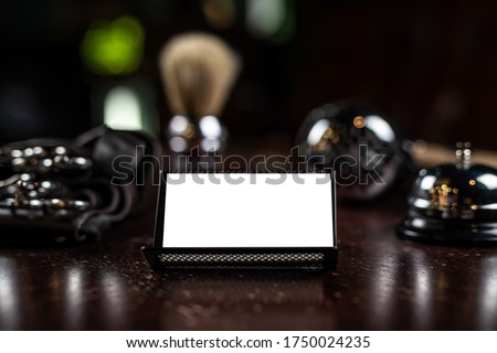 Mocap business card barber on a wooden table, chrome haircut accessories, beautiful bokeh