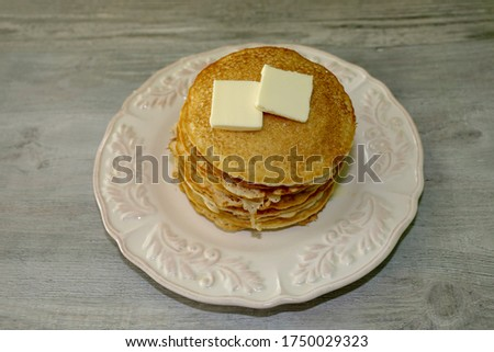 A delicious stack of pancakes with butter on top. hotcakes picture.
