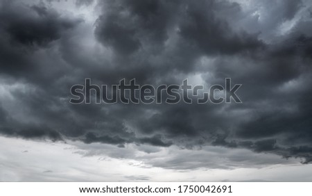 Dark clouds make sky in black. The rain is coming soon. Pattern of the clouds can not predict that Tornado, Hurricane or Thunderstorm. Sometimes heavy clouds is no rain but have Wind storm and thunder