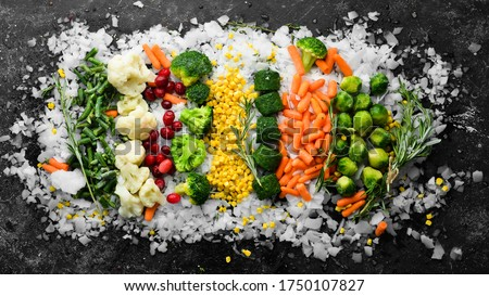 Assortment of frozen vegetables on ice. Stocks of food. Top view. Free space for your text. Royalty-Free Stock Photo #1750107827