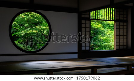 Buddhist temple and Green maple leafs in early summer, Kyoto Japan Royalty-Free Stock Photo #1750179062