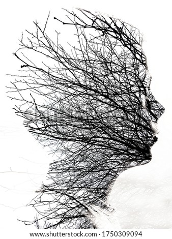 Portrait photography blends with nature texture, creating a dreamy mood. Double exposure portrait of little boy, combined with photograph of tree.