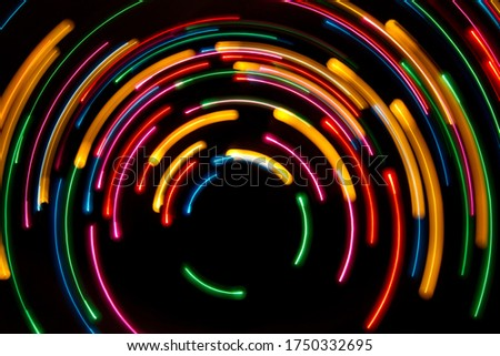 Light painting - semi circles on black background, abstract backdrop
