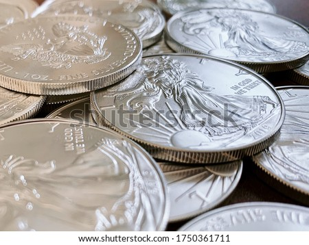 Set of American silver eagle coins, highlight the lady liberty side of the silver coin Royalty-Free Stock Photo #1750361711