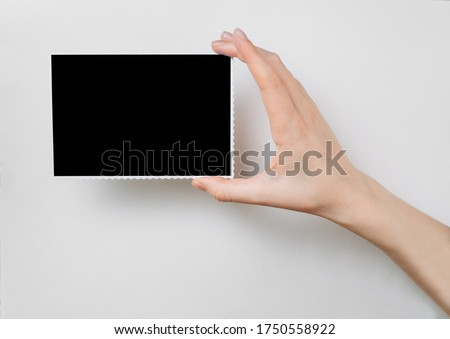 girl holds a photo frame in her hand.copy space