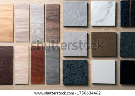 Sample of materials construction on wood background. Materials use for Interio designer. Home construction decorate room with luxury constructions set. Sample of Concretes and Wood laminate vinyl. Royalty-Free Stock Photo #1750634462