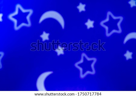 Blurred picture,Stars, moon and blue background